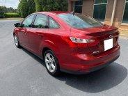 Cần bán xe Ford Focus 2014 màu đỏ số tự động, xe nhà chính chủ sử dụng kĩ giá 465 triệu tại Tp.HCM