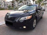 Bán Toyota Camry LE 2007 le nhập Mỹ màu đen xe rất mới giá 595 triệu tại Tp.HCM