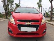 Bán Chevrolet Spark đời 2014, màu đỏ, xe gia đình giá cạnh tranh giá 235 triệu tại Tp.HCM