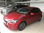 Bán Mazda 2 HB 1.5AT màu đỏ, số tự động, sản xuất 2016, một chủ bản 5 cửa giá 488 triệu tại Tp.HCM