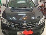 Cần bán Toyota Corolla sản xuất năm 2011, màu đen giá 610 triệu tại An Giang