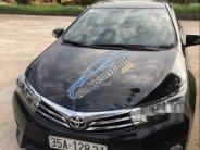 Cần bán xe Toyota Corolla altis sản xuất năm 2014, màu đen giá 615 triệu tại Ninh Bình