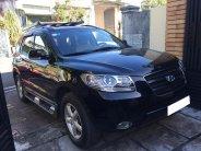 Bán Hyundai Santa Fe 2009 số sàn màu đen đi đúng 56.000 km rất mới giá 392 triệu tại Tp.HCM