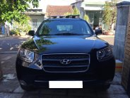 Bán Hyundai Santafe 2009 số sàn màu đen đi đúng 56.000 km rất mới giá 392 triệu tại Tp.HCM