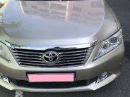 Em cần bán xe Toyota Camry 2.5Q đời 2013 số tự động màu ghi vàng giá 745 triệu tại Tp.HCM
