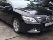 Xe Toyota Camry 2.0E đời 2014, màu đen, số tự động, giá tốt giá 705 triệu tại Hà Nội