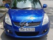 Cần bán Suzuki Swift 1.4 AT 2014, màu xanh lam chính chủ giá 400 triệu tại Hà Nội