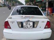 Cần bán Ford Laser Ghia 1.8 MT năm 2002, màu trắng giá 153 triệu tại Hậu Giang