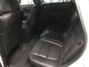 Bán Mazda CX5 2.0AT màu trắng, sản xuất 2015 đi 59000km xe đẹp giá 688 triệu tại Tp.HCM