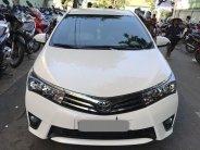 Gia đình cần bán xe Altis 2015, số sàn, màu trắng giá 574 triệu tại Tp.HCM