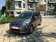 Cần bán xe Suzuki Ertiga 2016 số tự động màu xám titan giá 395 triệu tại Tp.HCM