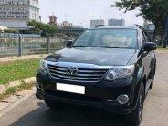 Gia đình cần bán xe Fortuner 2014, số tự động, máy xăng, màu đen bản full giá 623 triệu tại Tp.HCM