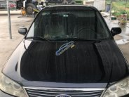Bán Ford Laser Ghia 1.8 AT 2005, màu đen, số tự động  giá 210 triệu tại Hà Nội