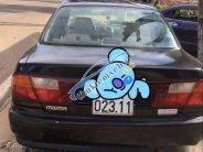Cần bán gấp Mazda 323 sản xuất năm 1998, màu đen, nhập khẩu nguyên chiếc chính chủ, giá chỉ 100 triệu giá 100 triệu tại Bình Dương