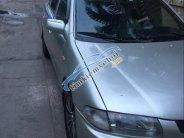 Cần bán lại xe Mazda 323 đời 2000, màu bạc giá 90 triệu tại Tp.HCM