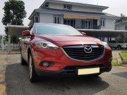 Cần bán xe Mazda CX9 model 2015, số tự động, màu đỏ 7 chỗ, bản full option giá 885 triệu tại Tp.HCM