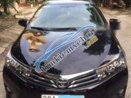 Bán Toyota Corolla Altis 1.8G AT 2014, màu đen xe gia đình giá 618 triệu tại Ninh Bình
