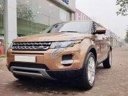 Bán Range Rover Evoque màu vàng, nội thất kem bản full option, xe sản xuất 2014 giá 1 tỷ 990 tr tại Hà Nội