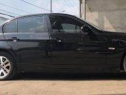 Cần bán xe BMW 320i, sản xuất 2007 đăng ký 2008, số tự động màu đen giá 345 triệu tại Tp.HCM