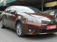 Cần bán xe Toyota Corolla altis sản xuất năm 2014, màu nâu giá 605 triệu tại Hà Nội