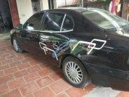 Cần bán lại xe Daewoo Leganza đời 2002, màu đen, nhập khẩu Hàn Quốc, còn rất đẹp giá 70 triệu tại Hà Nội