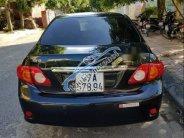 Cần bán lại xe Toyota Corolla altis G đời 2010, màu đen giá 385 triệu tại Nghệ An
