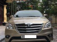 Cần bán gấp Toyota Innova E 2014, màu vàng, 480 triệu giá 480 triệu tại Hà Nội