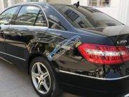 Bán Mercedes E250 đời 2010, màu đen giá 715 triệu tại Tp.HCM