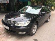 Cần bán lại xe Toyota Camry 2003, màu đen số sàn, giá chỉ 310 triệu giá 310 triệu tại Hà Nội