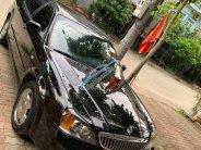 Cần bán lại xe cũ Daewoo Magnus năm 2004, màu đen giá 130 triệu tại Hà Nội
