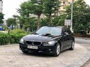 Cần bán BMW 3 Series sản xuất năm 2012, màu đen, nhập khẩu, odo chỉ 40.000 km giá 790 triệu tại Hà Nội