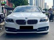 Bán BMW 535i 3.0L màu trắng/kem sản xuất 2014 giá 1 tỷ 390 tr tại Hà Nội