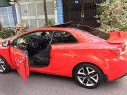 cần bán cọp Cerato 2011, số tự động, 2 cửa màu đỏ, còn mới tinh.  giá 467 triệu tại Tp.HCM
