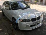 Cần bán gấp BMW 3 Series 318i năm sản xuất 2004, màu trắng, giấy tờ chính chủ giá 230 triệu tại Tp.HCM