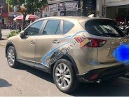 Bán xe Mazda CX 5 sản xuất 2015, màu vàng, chính chủ giá 705 triệu tại Đà Nẵng