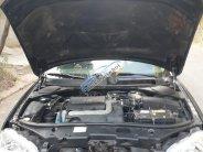 Cần bán lại xe Ford Mondeo đời 2003, màu đen, còn mới, giá 110tr giá 110 triệu tại Tp.HCM