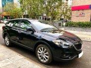 Cần bán xe CX9, sản xuất 2013, số tự động, nhập Nhật, màu đen huyền thoại giá 825 triệu tại Tp.HCM