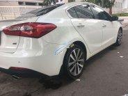 Chính chủ bán xe Kia K3 đời 2014, màu trắng, full options giá 495 triệu tại Tp.HCM