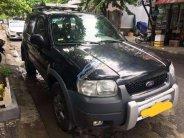Gia đình bán ô tô Ford Escape đời 2004, màu xanh đen giá 210 triệu tại Đà Nẵng