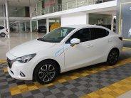 Cần bán Mazda 2 1.5AT Sedan đời 2016, màu trắng, giá 468tr giá 468 triệu tại Tp.HCM