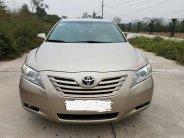 Cần bán xe Camry LE 2007 số tự động, màu vàng cát giá 498 triệu tại Tp.HCM