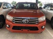 Toyota Hilux 2.4E (4x2) số sàn trắng, bạc, màu cam giao ngay- khuyến mãi tốt giá 622 triệu tại Tp.HCM
