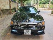 Bán Daewoo Magnus 2004, màu đen, full options giá 150 triệu tại Hà Nội