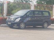 Cần bán Hyundai Grand Starex 2.5 MT đời 2011, màu đen  giá 590 triệu tại Tiền Giang