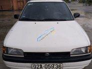 Cần bán lại xe Mazda 323 năm sản xuất 1995, màu trắng, xe nhập, giá cạnh tranh giá 60 triệu tại Quảng Nam