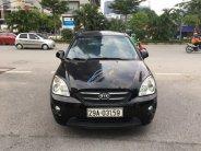 Bán Kia Carens 2.0MT năm sản xuất 2011, màu đen, số sàn  giá 285 triệu tại Hà Nội