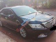 Cần bán gấp Toyota Camry 2.0E năm 2013, màu đen giá 730 triệu tại Đồng Nai