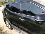 Cần bán xe Hyundai Santa Fe năm sản xuất 2016, màu đen, xe gia đình giá 970 triệu tại Tp.HCM