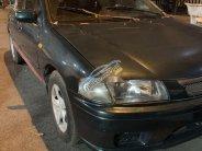 Cần bán gấp Mazda 323 đời 2000, màu xám giá 84 triệu tại Tp.HCM