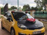 Bán Kia Rio 1.4 MT đời 2015, màu vàng, xe nhập  giá 290 triệu tại Đắk Lắk